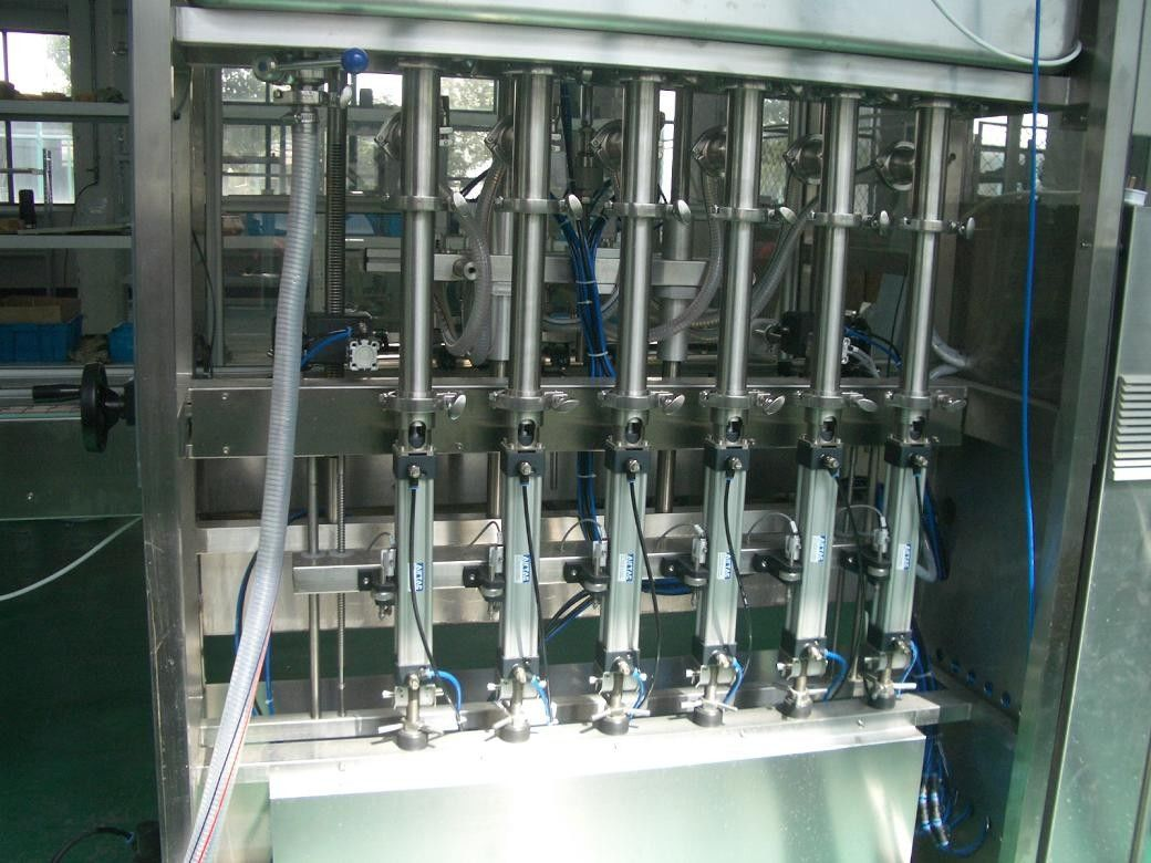 25 ~ 30 bpm Piston Filling Machine with 6 to 12 filling nozzles for Oil, Syrup & Detergent